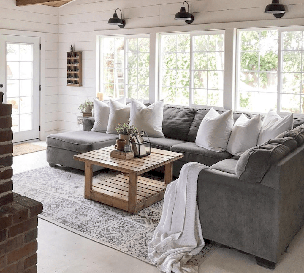 Welcoming Living Room Designs with Comfortable Grey Sectional Sofa and Pallet Coffee Table