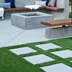 Modern outdoor living area with cozy furniture and firepit Part 14