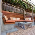 Modern outdoor living area with cozy furniture and firepit Part 16