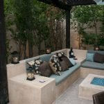 Modern outdoor living area with cozy furniture and firepit Part 23