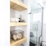 Open shelving and builtin cabinets for lots of extra bathroom storage Part 24