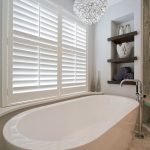 Open shelving at end of a bathtub for more efficient bathroom organization Part 31