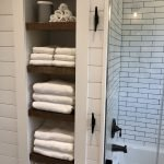 Open shelving at end of a bathtub for more efficient bathroom organization Part 33