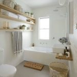 Open shelving at end of a bathtub for more efficient bathroom organization Part 34