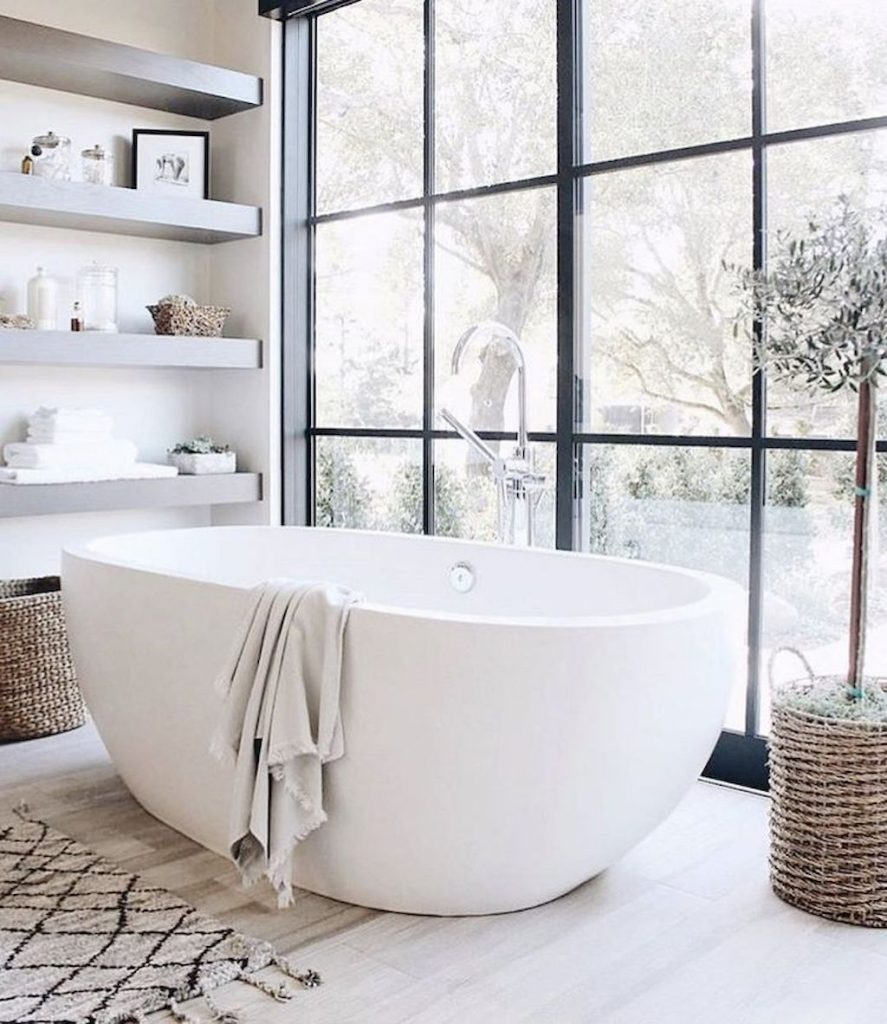 https://elonahome.com/wp-content/uploads/2019/01/Open-shelving-at-end-of-a-bathtub-for-more-efficient-bathroom-organization-Part-38-887x1024.jpg
