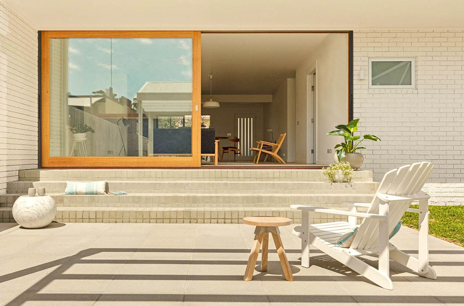 A cozy outdoor family area of successful Rozelle Burrow project by Benn and Penna Designs