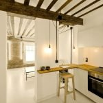 Art home renovation bringing an old structure into livable modern living space in Madrid