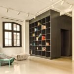 Black and ligh wood accent applied as partition and wall mouned shelf in MCGILL 120 renovation for a loft in Vieux Montreal (2)