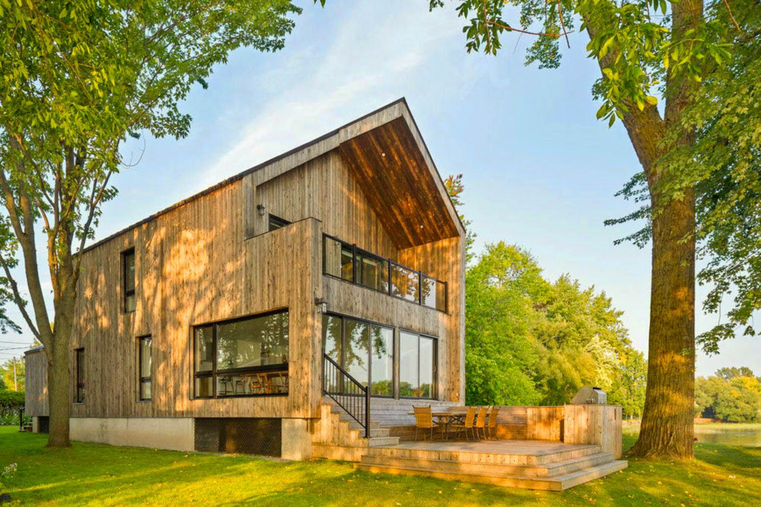 https://elonahome.com/wp-content/uploads/2020/06/Impresive-wood-cladd-exterior-to-show-Saint-Placide-Chalet-with-extensive-concept-that-grabs-more-warmth-welcome-for-the-family-2.jpg