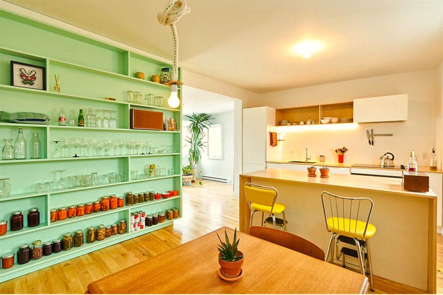 https://elonahome.com/wp-content/uploads/2020/06/Retro-style-of-Green-wall-shelf-to-mantain-style-and-function-in-Marconi-Renovation-done-by-la-Firme-2.jpg