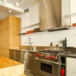 Wood accent as partition and cabinetry in MCGILL 120 renovation for a loft in Vieux Montreal (5)