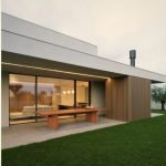 Impressive architecture work underscoring flat roof house style in the middle of green grass field (1)