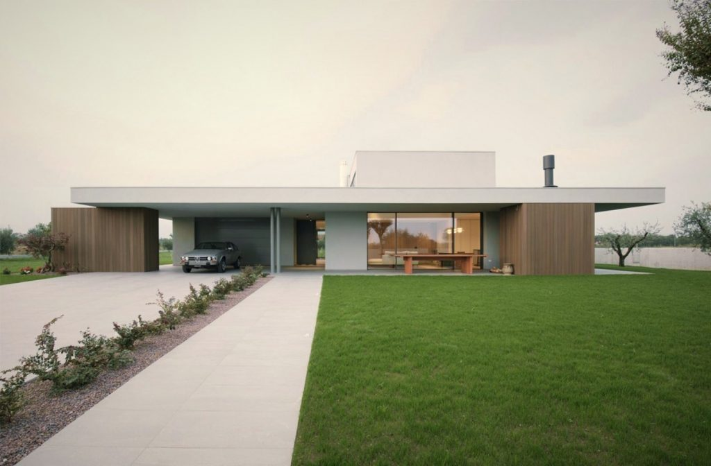 https://elonahome.com/wp-content/uploads/2020/07/Impressive-architecture-work-underscoring-flat-roof-house-style-in-the-middle-of-green-grass-field-1024x672.jpg