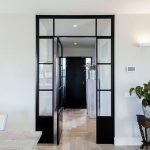 Black white barn house design showing open interior concept with seamless modern home characteristics Out Of The Box (5)