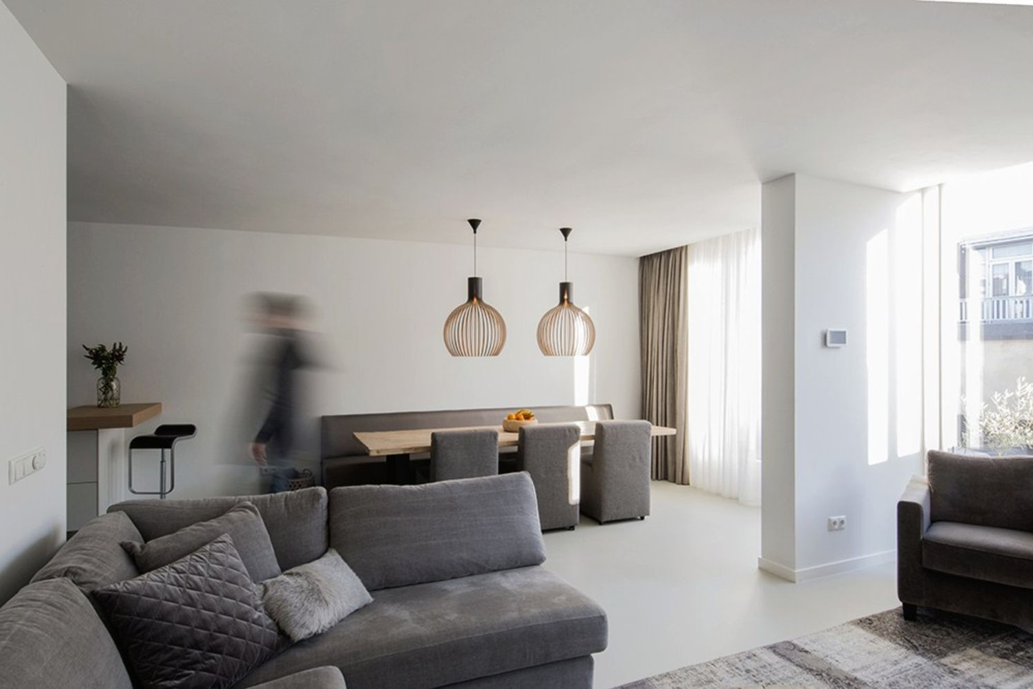 Bright tranquil house from Arjen Reas with homey interior design illuminated by natural light House K (1)