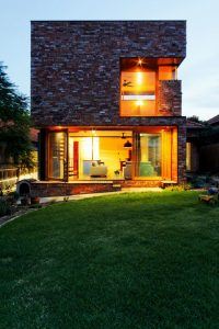 Ecofriendly house concept adapting aesthetic contemporary style showcasing brick outside wall in prominent cube design Ilma Grove (4)