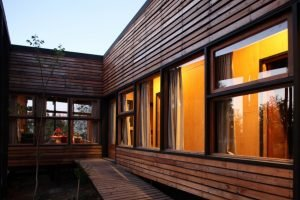 Single family house built in the middle of an orchard adopting cabin style with exposed wooden wall Casa Lo Cañas (2)
