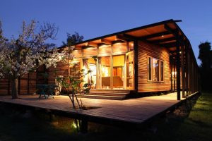 Single family house built in the middle of an orchard adopting cabin style with exposed wooden wall Casa Lo Cañas (3)