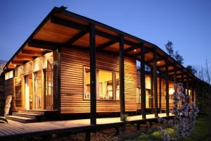 Single family house built in the middle of an orchard adopting cabin style with exposed wooden wall Casa Lo Cañas (4)