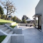 Enhanced style of House F sited on slope with multipurpose exterior space