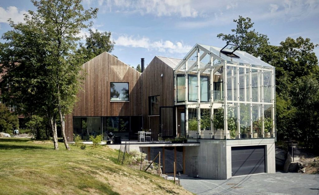 https://elonahome.com/wp-content/uploads/2020/12/Special-family-house-designed-for-more-natural-vibes-enhanced-with-attached-greenhouse-for-garden-and-lounge-2-1024x628.jpg